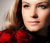 Stylish woman holding roses flower