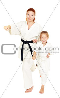 Mom and daughter with a smile in a kimono hit a hand on a white background