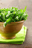 fresh green salad arugula in a wooden bowl