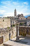 panoramic view of tipical water dispenser and church of Matera under blue sky