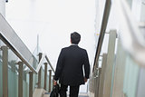 Indian businessman descending steps