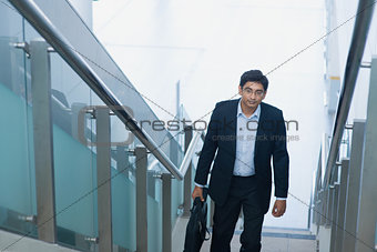 Asian Indian businessman ascending steps