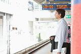 Indian businessman waiting train