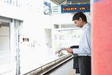 Indian business man waiting train