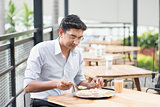 Indian businessman eating food