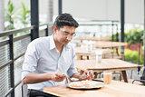 Indian businessman eating food