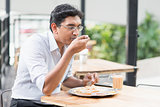 Indian business man eating food