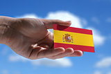 Small Spanish flag against sky