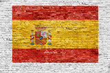 Spanish flag painted on brick wall