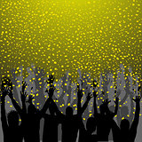 Nightclub party with hands in air and golden confetti