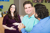 Happy Male Couple with Surrogate Mother
