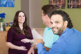 Gay Man with Partner and Pregnant Woman