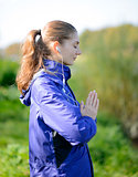 Young Beautiful Woman Meditate in the Park