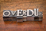 overdue word in metal type