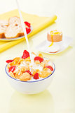 Delicious breakfast. Corn flakes with milk and strawberries.