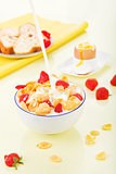 Corn flakes with milk and strawberries.