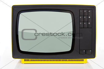 Antique yellow television.