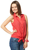 Pretty brunette in blue jeans and a red shirt on white background