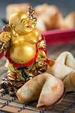 Laughing Buddha and the Chinese cookies.
