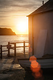 Lovely sunrise behind fishing hut in Lulworth Cove with added le