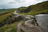 Landscape of collapsed A625 road in Peak District UK