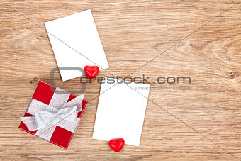 Blank valentines photo frames and small red gift box