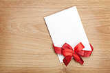 Blank valentines greeting card and red ribbon