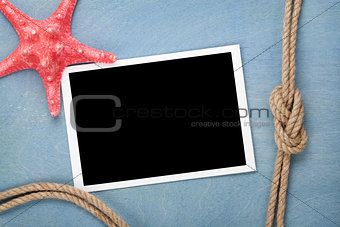Blank photo frame with starfish and ship rope