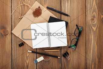 Office table with notepad, vintage envelope and supplies