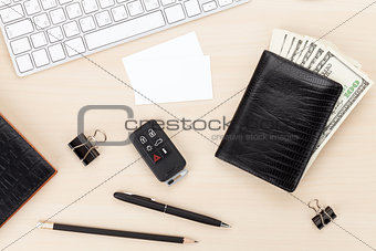 Office table with pc, supplies, business cards and money cash
