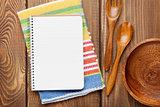 Wood kitchen utensils over wooden table