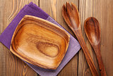 Wood kitchen utensils over wooden table