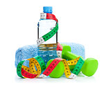 Two green dumbells, tape measure and drink bottle