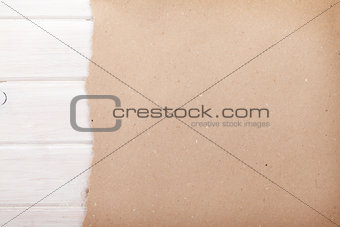 Cardboard paper over white wood background