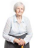 Portrait of a senior woman looking at the camera. Over white background.