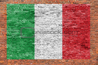 Flag of Italy painted over brick wall