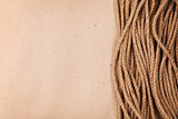 Brown cardboard paper background with marine rope