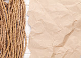 Brown rumpled cardboard paper background with marine rope