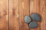 Wooden background with sea stones