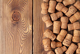 Champagne wine corks over wooden table