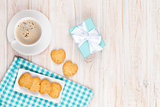 Cup of coffee, heart shaped cookies and gift box