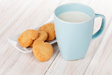 Cup of milk and heart shaped cookies