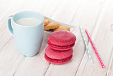 Cup of milk and macarons