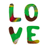 Plasticine letters forming word LOVE written on white background