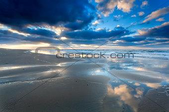 blue sky cloudscape reflected in North sea
