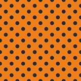Black polka dots on orange vector background