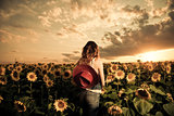 woman in sunflowers field