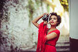 Beautiful woman in urban background. Vintage style
