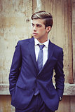 Attractive young businessman in urban background