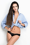 Beautiful seminude woman in blue shirt and panties